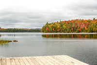 Lake with Fall Colours and Dock in the Foreground - Algonquin Pr