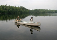 Canoeist with Springer Spaniel Navigating